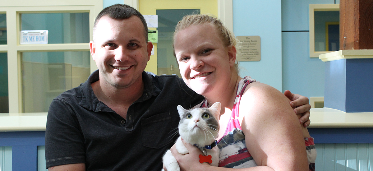 military couple with adopted cat Celine