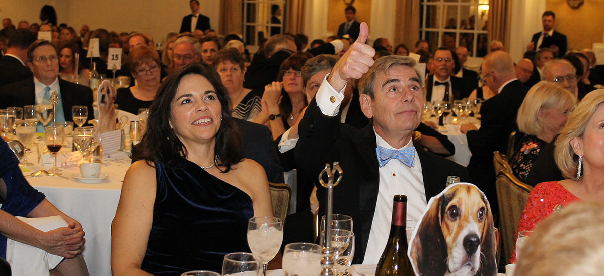 Katherine and Jack Nelson signaling to auctioneer during the Richmond SPCA Fur Ball at The Jefferson Hotel