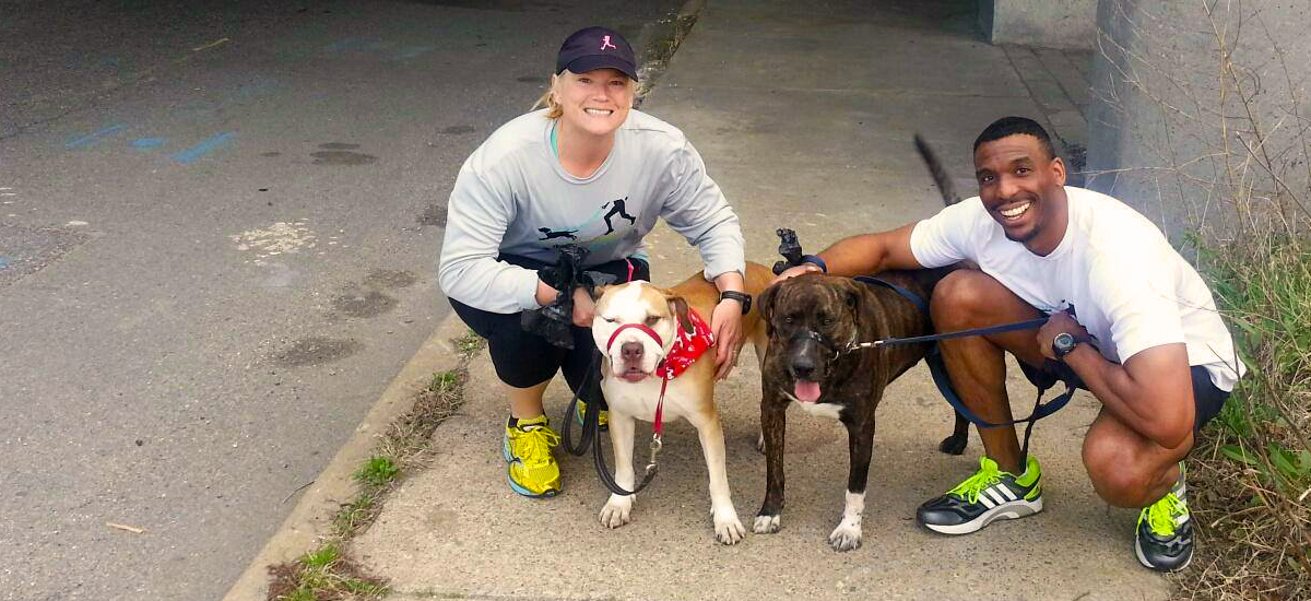Running Buddies volunteers Janice Akers and Stephen Carter with dogs Lenora and Snoopy