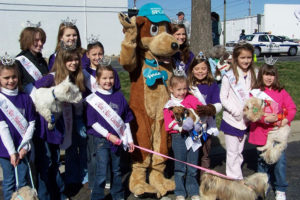 Emily Kinsey and the Princesses for Pets team with Waggles at the Dog Jog