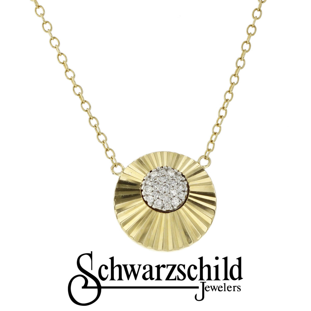 gold and diamond necklace with schwarzschild logo